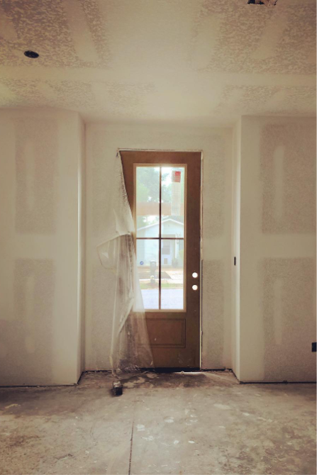 Construction site, front door entrance, progress.
