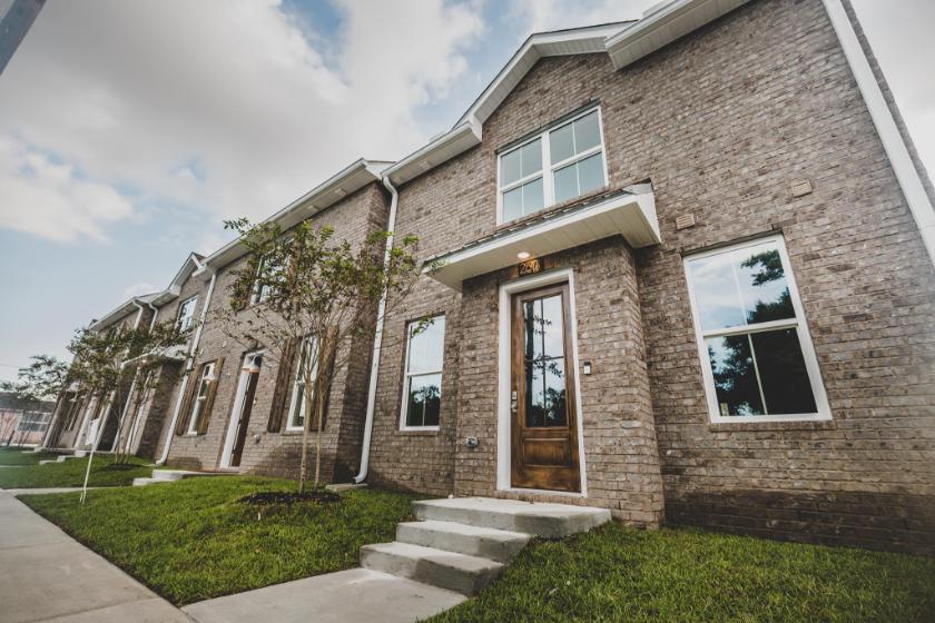 aDoor home, brick building, inviting front door.