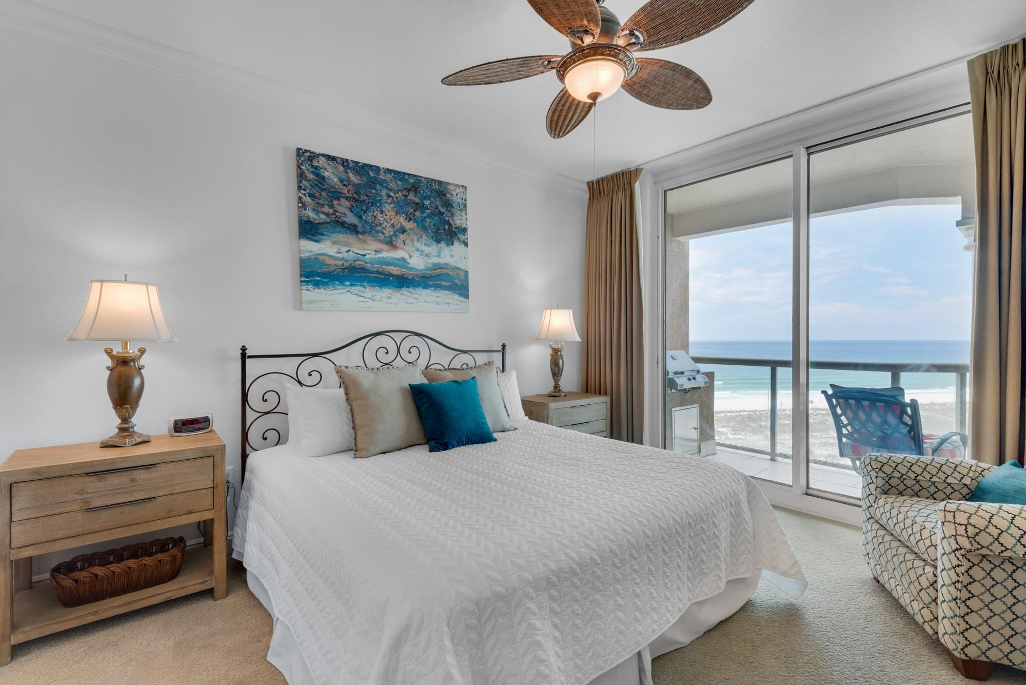 Beach condo master bedroom, overlooking Gulf Coast, classy interior design with turquoise, cream, and white.